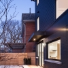 black sliding doors and large picture window elements