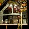 Colin & Justin Cabin Pressure cottage with black bi-parting sliding door and tilt turn windows
