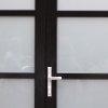 """Lever hardware in brushed nickel finish on a Hinged Entry featuring 2"""" SDL and acid etched glass.  Lever hardware comes in Black or Brushed Nickel finishes and is a keyed entry."""