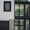 renovation revival included a glass breezeway and black framed tilt turns